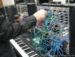 Modular Synthesizer Being Patched